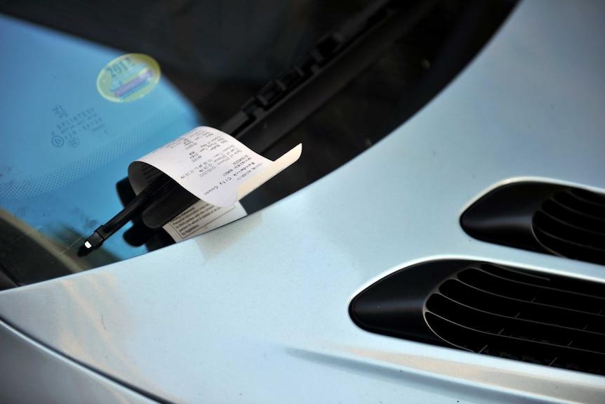 A parking fine on a windscreen.