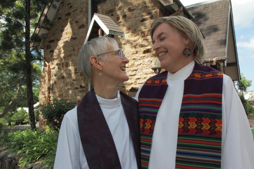 Penny Jones with Jo Inkpin, outside their church.
