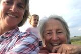 Two smiling women.