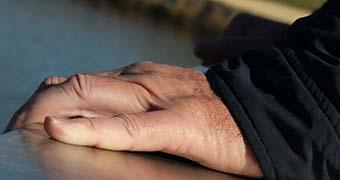 Hand on a bridge (generic for depression)