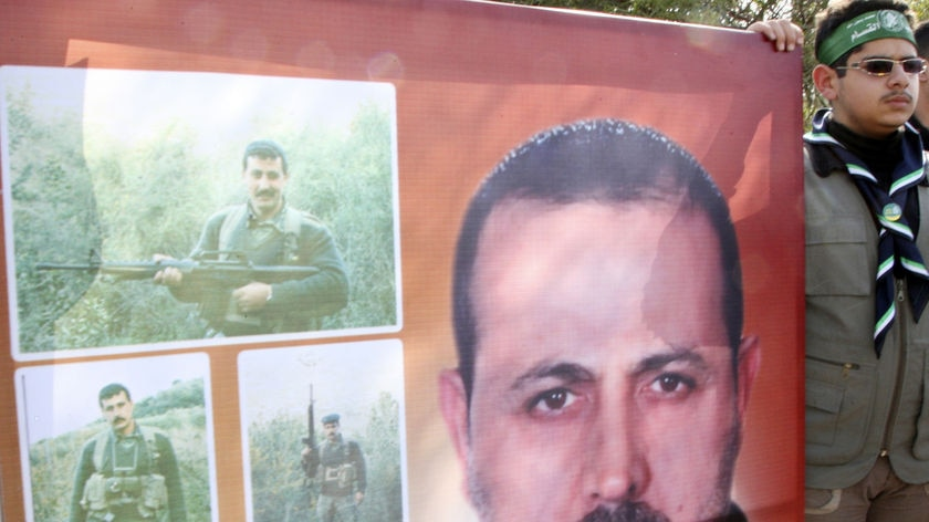 A Palestinian supporter of Hamas holds a picture of Mahmoud al Mabhouh, a senior Hamas military comm