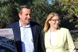 Premier Mark McGowan wearing a navy jacket and pale blue shirt stands next to Rita Saffioti, who wears a lemon jacket.