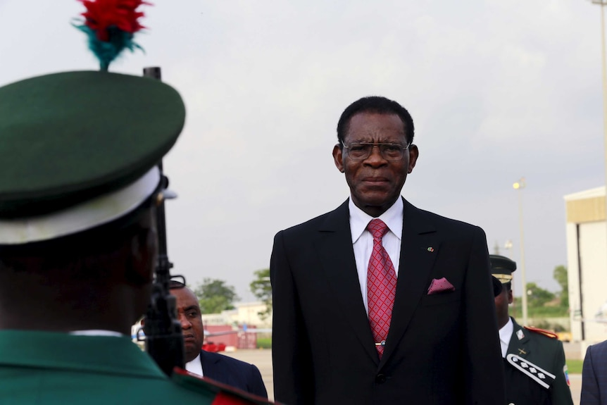 Teodoro Obiang stands in a suit.
