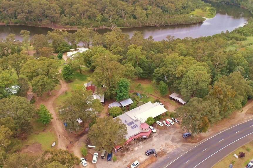 A small caravan park sits next to picturesque rivers and bushland