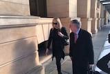 Alana Bartels (left) walks with lawyer Stephen Ey.