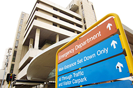 Upshot of Sir Charles Gairdner Hospital in Perth with emergency department sign in foreground.