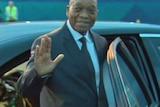 Jacob Zuma waves his hand.