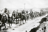 An Australian Light Horse regiment passes through Jerusalem mounted on horseback.
