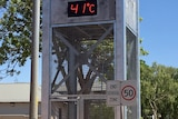 A clock tower shows 41C on the temperature gauge.