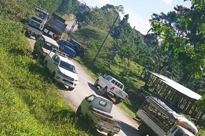 Trucks block the road and entrance to the refugees' accommodation on Manus Island