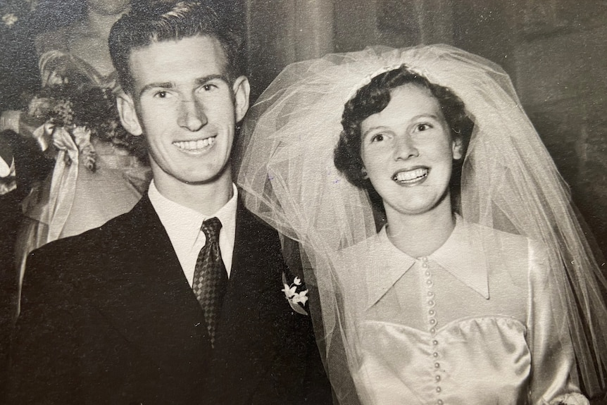 Black and white photo from 1951 of a couple getting married.