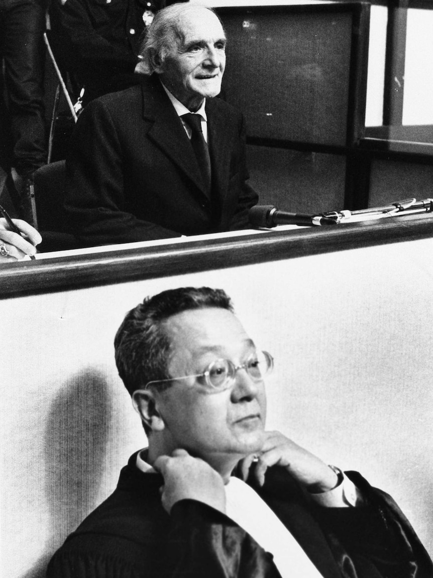 Jacques Verges sits in front of Klaus Barbie in the Lyon Assize court.