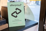 Afterpay sign with logo on counter