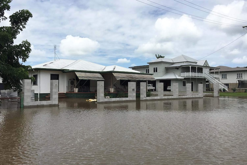 Flooded street and houses in Ingham in north Queensland.