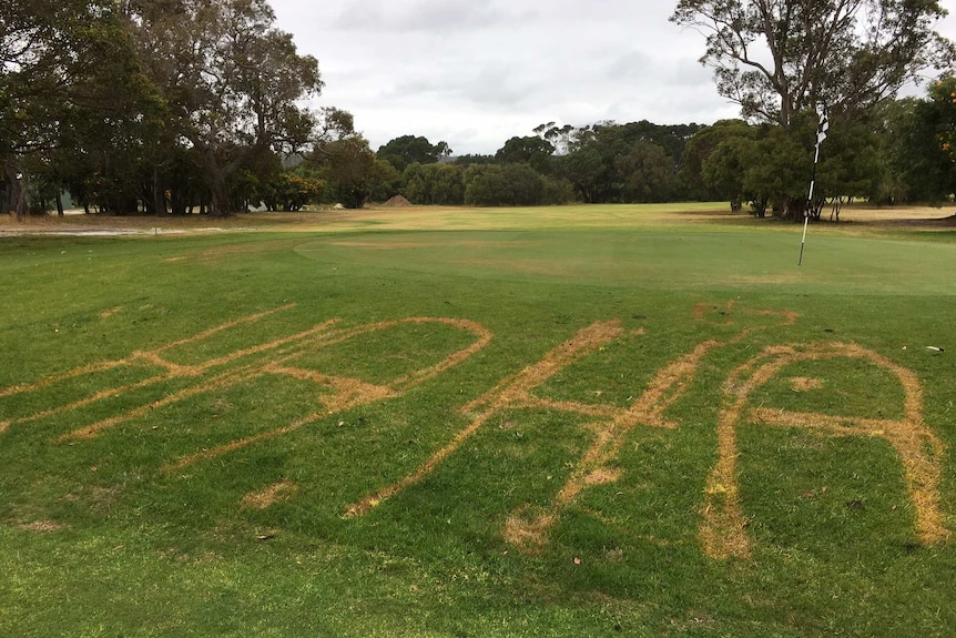 """The words """"ha ha"""" written in the grass of a golf green"""