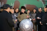North Korean leader Kim Jong-un speaks with scientists about nuclear arsenal