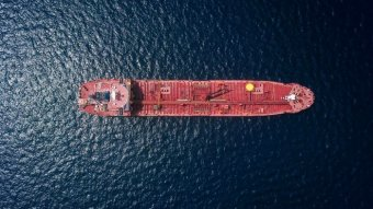 A container ship at sea, viewed from above.