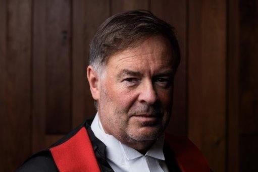 Portrait photo of Gregory Geason.