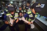 Police take away a protester