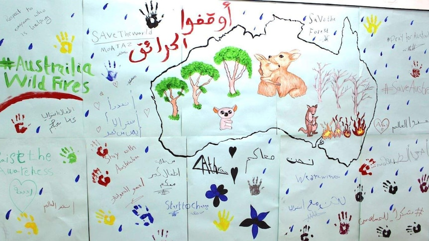 Group drawing by Syrian refugee children of kangaroos, messages in Arabic and English.