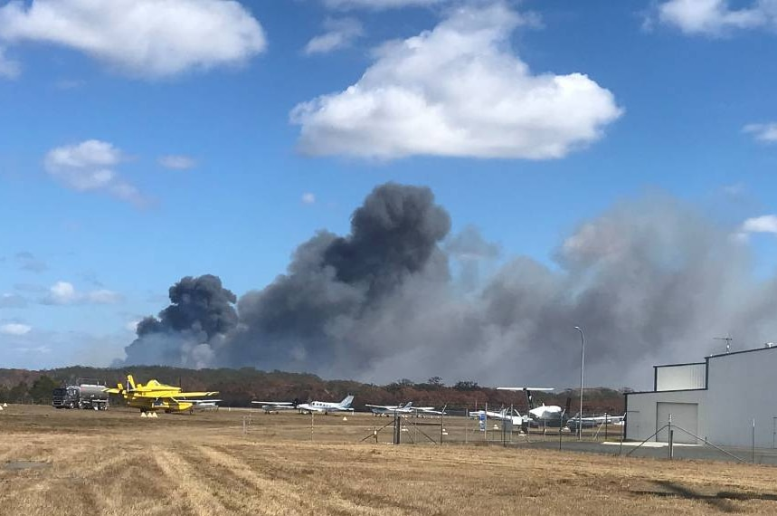 The fire near Port Macquarie Airport burning in wetland