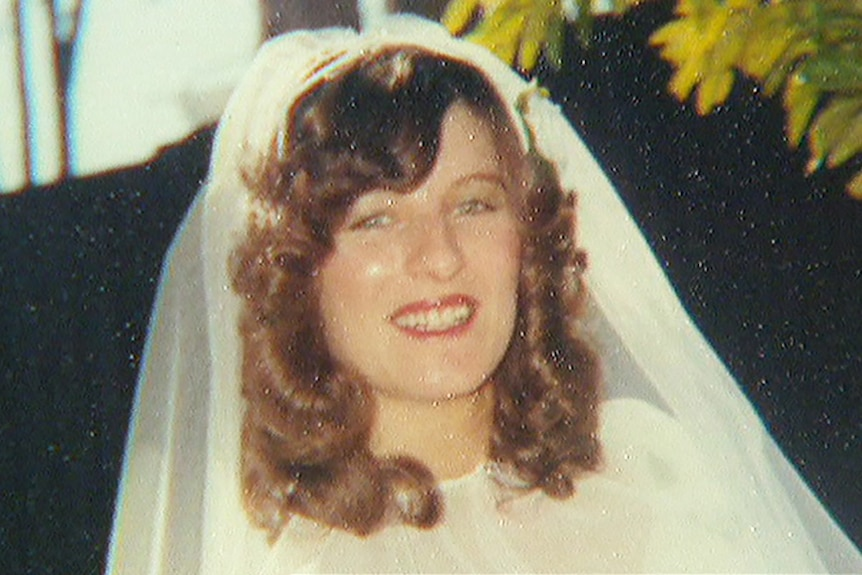 A grainy image of a smiling Linda Reed in a wedding veil.