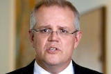 Headshot of Scott Morrison, looking straight ahead as he speaks during a press conference.