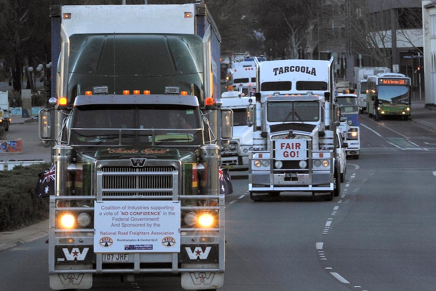 A convoy of trucks protesting against the carbon tax make their through the Canberra CBD