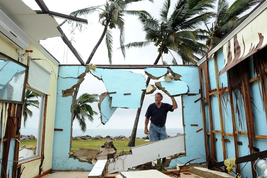 Greville Blank surveys his destroyed home in the devastated in Tully Heads on February 4, 2011