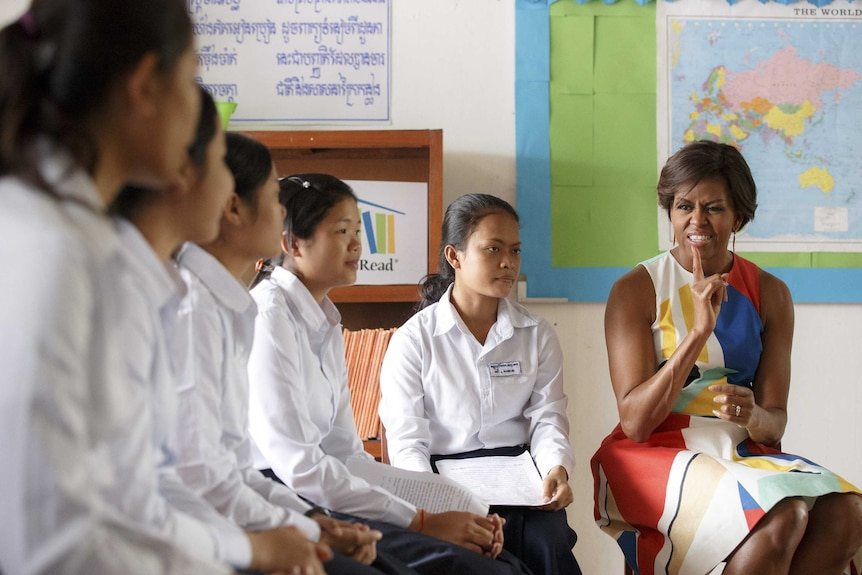 Michelle Obama gestures as she speaks to students during a visit to promote girls' education at Hun Sen Prasaat Bankong high school on the outskirts of Siem Reap