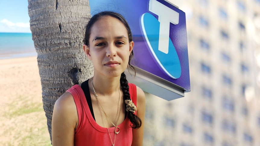 Caitlyn Roe and a composite of a Telstra logo.