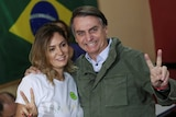 Brazil president-elect Jair Bolsonaro poses with his wife before voting.