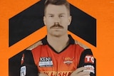 David Warner folds his arms and looks serious in his Sunrisers Hyderabad kit.
