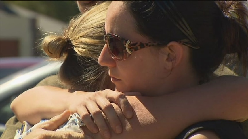 Families and friends mourn as missing plane search continues