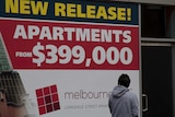 Sign advertising apartments for sale