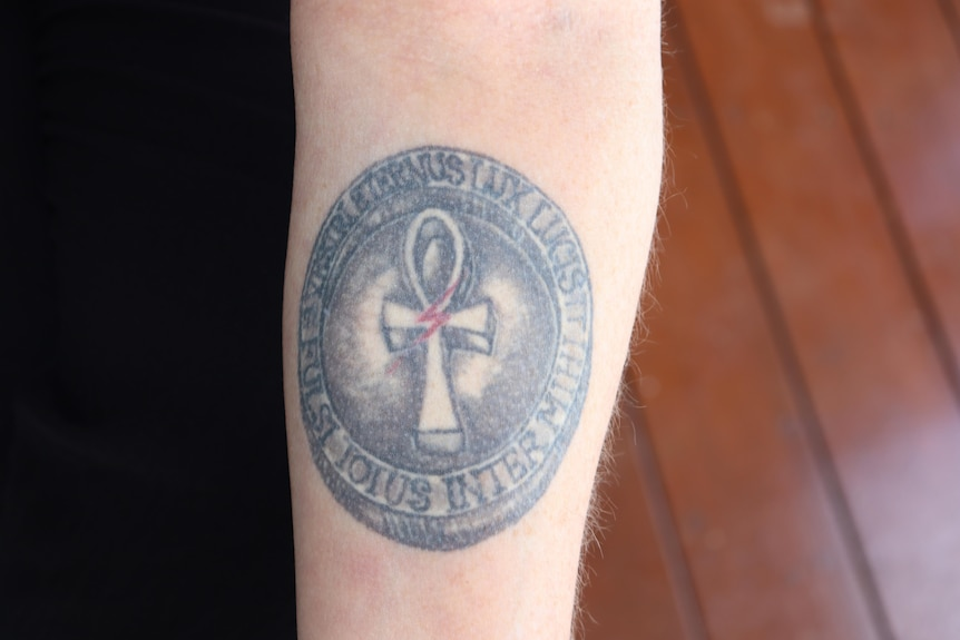 A round tattoo on a woman's arm. For a story on getting a memorial tattoo after the loss of a son.