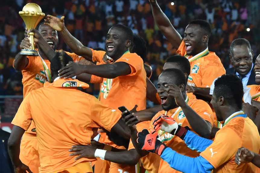 Ivory Coast celebrates with African Nations Cup trophy