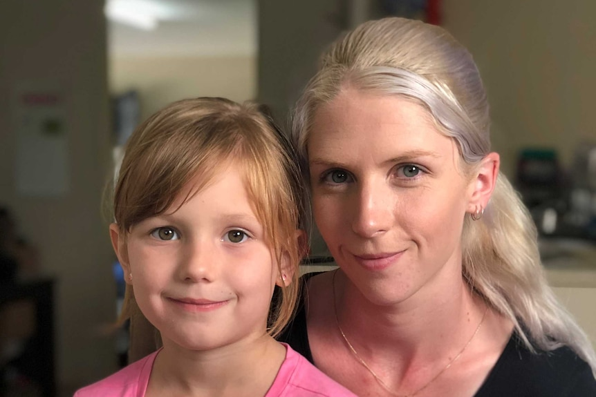 Emma Taylor holds her six year old daughter Felicity