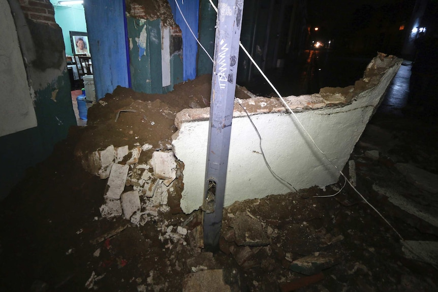 Damaged entrance to a home in Oaxaca - the entire side of the house is collapsed