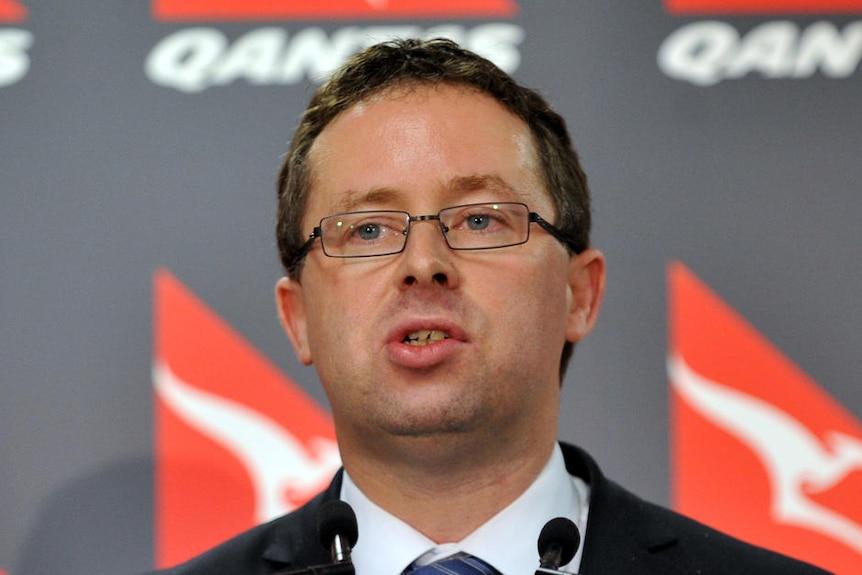 Qantas CEO Alan Joyce speaks to the media