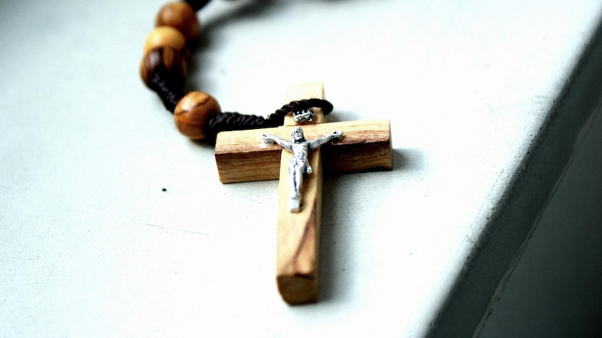 A crucifix cross on a bead necklace