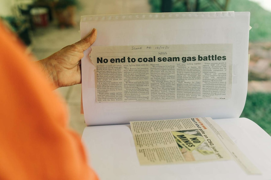 A newspaper clipping reading 'no end to coal seam gas battles'