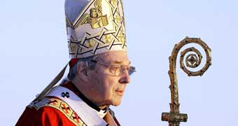 Cardinal GeorgePell in 2008 wearing headdress and holding staff