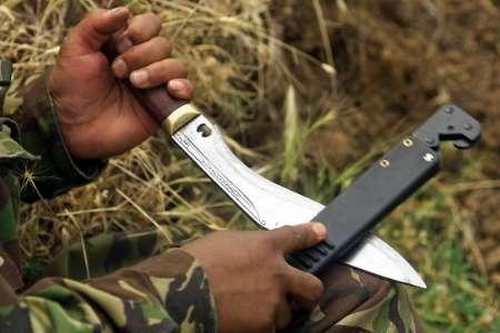 Gurkha sharpens his Khukri knife