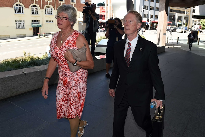 A woman and man arrive at court