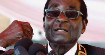 Robert Mugabe speaks into microphones.