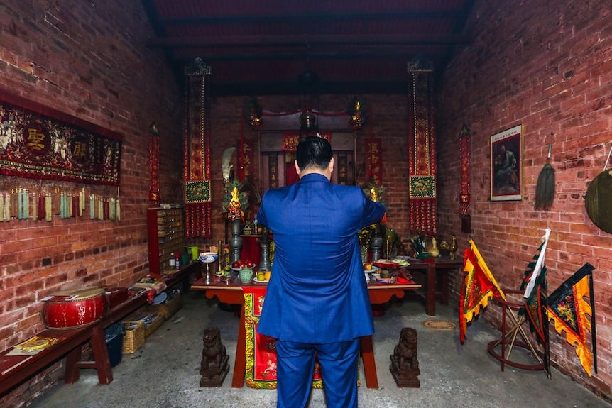 Bendigo surgeon Manny Cao at the main altar credits the temple with bringing him good fortune.