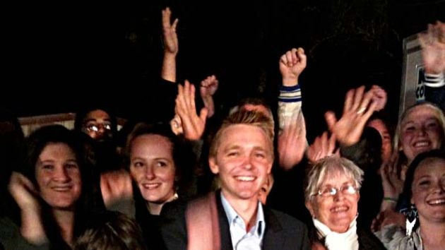 Wyatt Roy, celebrates with supporters after winning the seat of Longman.