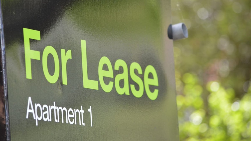 """A black sign with green letters reading """"For Lease, Apartment 1""""."""