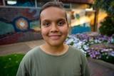 A young Aboriginal girl smiling
